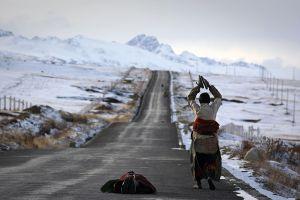 Derge, East Tibet, China: Pilgrims prostrating on their long way to Lhasa. © Matjaz Krivic