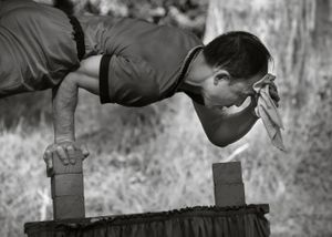 Balancing Act: A Chinese acrobat exhibits masterful strength, discipline and humor during a street performance. Donations welcome.
