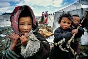 Darchen, Tibet: Tibetan children whose parents went on a pilgrimage around holy Mount Kailash in Western Tibet. © Matjaz Krivic