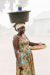 A. Irene: Sells Ground Nuts for 1,000 shillings per cup. Earns an average of 30,000 shillings ($8.00) a day.