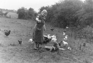 """Granny Feeding the Hens. From the exhibition """"Landscapes"""" © Tom Wood"""