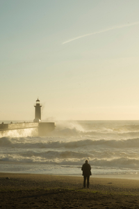 The man, the lighthouse and the sea