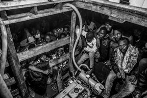 Migrants packed in to the hold of a large wooden boat