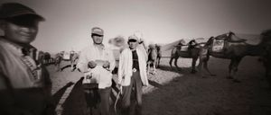 Dunhuang camel herders at Mingsha Shan Sand Dunes (Echoing-Sand Mountain). Near the junction of the Northern and Southern Silk Roads, China