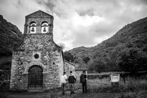 Some residents visit an old church in a nearby village