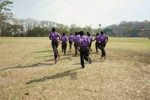 The girls run during a training session. Malawian Under 19 Women's Cricket Team, Blantyre, Malawi, 2016.