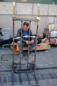 Two men in two different worlds of their own, Istanbul