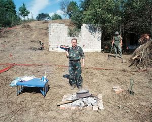 Army Cooks, Croatia, 2007. If we happen to stray into a minefield while catching a calf, we keep a safe distance and follow in its footsteps until it returns to the paved street. In that moment we catch the calf, lead it into the stockade, kill it and cut it into pieces. © Martin Kollar.