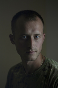Roman, 26, sales manager, picture was taken after he spent 12 months in the war zone, July 2015, Ukraine.