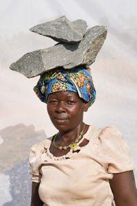 Abur Janet: Earns 1,000 shillings ($0.32) per Jerrycan of gravel. Makes 10 jerrycans of gravel per day at 1,000 shillings per.