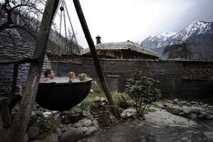 Sochi tourists warm up in a luxurious sauna complex called British Banya. The Russian State granted its people ten days off in early January. Life has halted, a man is at his own disposal and is suspended in the vacuum of idleness. People rush to health resorts looking for active and passive rest. They like to go to Krasnaya Polyana. Connoisseurs and sybarits prefer more traditional pleasures but