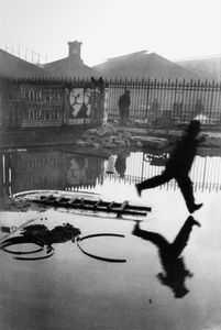 """Behind the Gare Saint-Lazare. From """"The Decisive Moment."""" © Henri Cartier-Bresson / Magnum. Published  by Simon and Schuster in the US and Editions Verve in France. Most recently reprinted by Steidl."""