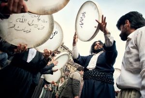 Howraman Takht, Iran: Pilgrims in the Kurdish part of Iran celebrate the pre-Islamic religious holiday of Aroosi Pir Shahriar. The men are playing the Daf drums while the dervishes are reaching a trance like state through their dance. © Matjaz Krivic