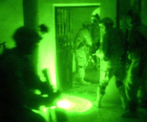 Seen through a night-vision device, paratroopers conduct a raid on a suspected terrorist's home in Fallujah, Iraq. The Soldiers are assigned to the 82nd Airbourne Division's Company B, 1st Battalion 505th Parachute Infantry Regiment. This photo appeared on www.army.mil © U.S Army