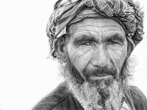 An afghan fisherman returns from a day on Amu Darya river bordering Tajikistan.