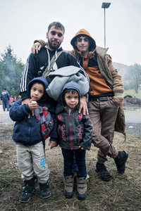 Matisha with his children and a friend, from Afghanistan, on their way towards Austria, on the bordercrossing in Spielfeld.