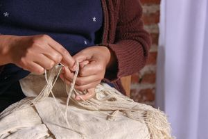Hands Making Fringe On A Hand-woven Silk Shawl, San Pedro Cajonos Oaxaca Mexico