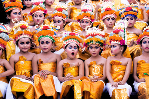 """Image was taken in Bali during Melasti Festival. This festival is conducted once a year in conjunction with Nyepi or Silent Day. These young girls wait for their turn to perform. They looked stunning with their bright coloured costumes and heavy make-up on, however the expression on each of the girls' faces (especially the yawning girl) gives this image an extra """"ummpph"""""""