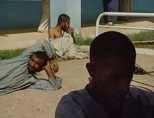 Baghdad, Iraq (2003). The Al Rashad mental hospital during the US-led invasion of Iraq.  Men ward.
