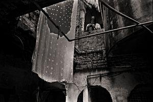 Bashona Dutt cleaning lice from daughter Joya's hair. Pannitola, 2004. © Munem Wasif