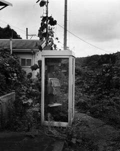 """An abandoned telephone box at Momouchi station. The station has remained untouched since the nuclear disaster. From the series """"Fragments/Fukushima"""" © Kosuke Okahara"""