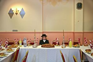 A 13 year-old Orthodox Jewish boy sits waiting for his Bar Mitzvah to begin in a Parces hall, Stamford Hill. The Bar Mitzvah signals the coming of age for a young Jewish boy, they become responsible to observe the commandments of the Torah. It coincides with physical puberty and they begin to participate in all areas of Jewish life.