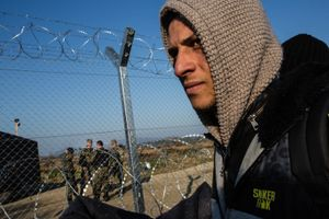 December 2015, Greek-Macedonian border near Idomeni. A refugee waits for hours to cross the Greek Macedonian borrder as the Macedonian border police looks toroughly at all documents because they just decided that only Syrians, Afghans and Iraqi can pass. Because Macedonia closed its border, thousands of refugees are stuck in dire conditions at the Greek side of the border.