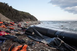 life vests and rubber boats at coast of Lesbos