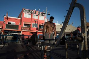 Venice beach Boardwalk, bodybuilder at the muscle beach.