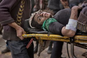 A woman injured by Syrian government shelling lies wounded on a stretcher outside of a field hospital in the Shaar district of Aleppo on February 10, 2013. © Nish Nalbandian