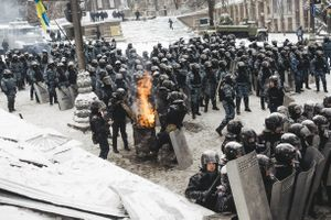 The police near the government district, basking near barrels with fire, as the air temperature sometimes reaches -30 degrees. Kyiv, Jan. 22, 2014.