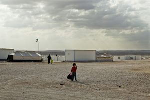 A young boy wandering around in the camp. © Tom Verbruggen