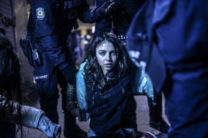 Girl wounded during clashes between riot police and protestors, Istanbul, 12 March. Spot News Singles, 1st place. Bulent Kilic, Turkey, Agence France-Presse.
