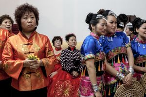 Members of the Chinese Evangelical Church in Via Assisi, southern Rome, wait to get on stage during the Christmas show on December 25th 2014.