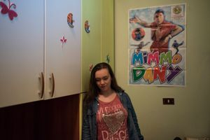Rosa Visalli, 18 years old, poses inside her room. She is a great fan of Mimmo Dany.