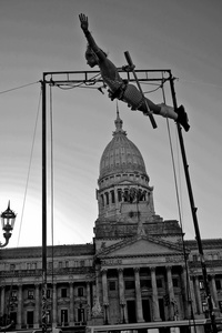 El Circo Abierto (Open Circus) protest against the congress in Buenos Aires.  The group is asking for a law to help and protect the actors.I saw this image as a reflection of the country and myself: in the air, a tight balance, but with hopes.  I do not know if we both reach our goal: the country stability and progress; myself stability and sanity.  Guess we trying.