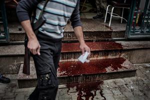 A puddle of blood trickling down from Dar Al-Shifa hospital entrance.