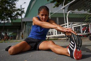 Maritza Arango, 38, stretches before a training session at Atanasio Girardot Stadium in Medellin, June 2016.