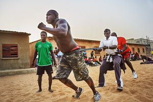 Lac de Guiers 2 has to run and pull his eponym, the Ex-Wrestler Lac de Guiers 1, through the sand. March 30, 2015. Lac de Guiers was once a member of Balla Gaye's school. After a discussion with Balla Gaye he founded his own school.