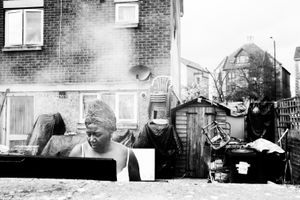 Woman cooks on barbecue.