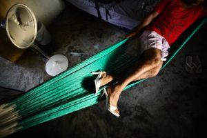 Reyna spending the siesta in his hammock in Oasis. © Meeri Koutaniemi