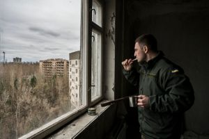 Maxim Rudyavsky brushes his teeth in Pripyat