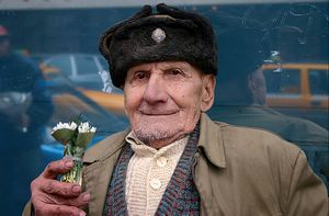 ROMANIA, BUCHAREST, WAR VETERAN SELLING FLOWERS