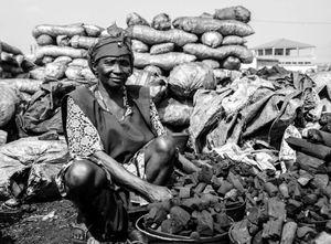 Women Workers. Coal seller