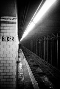 Man on Bleecker Street subway platform, New York, 2002 © Jehsong Baak