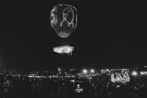 Hand-made balloons are launched into the air from the crowd