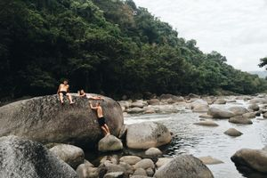 People, rocks, and river.