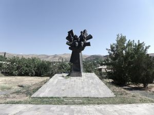 Ujan genocide monument features faces of seven Armenian resistance fighters.