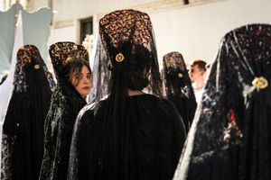 A young woman in traditional mourning veil.