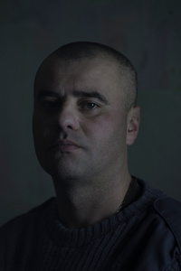 Vitaliy (Victor), 29, worker, picture was taken after he spent 12 months in the war zone, January 2016, Ukraine.